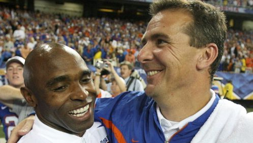 Florida's Charlie Strong and Urban Meyer (right) celebrate t