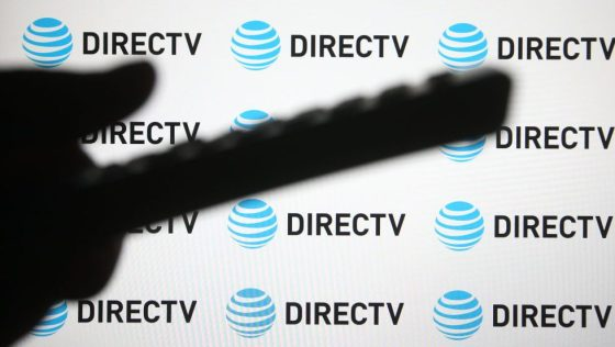 In this photo illustration a DirecTV logo of a US direct