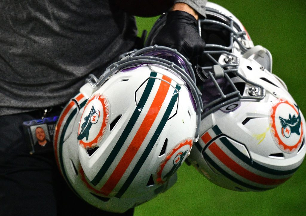 """Dolphins players """"stand in solidarity"""" with those who skip in-person w... image"""