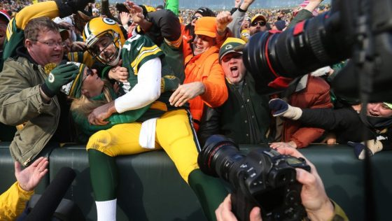 Green Bay Packers quarterback Aaron Rodgers (12) celebrated his second quarter rushing touchdown with fans at Lambeau Field Saturday December 24,2016 in Green Bay, Wis. ] The Green Bay Packers hosted the Minnesota Vikings at Lambeau Field. Jerry Holt / je